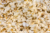 Salted popcorn background — Stock Photo