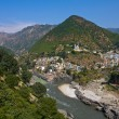 Devprayag is last prayag of AlaknandRiver and from this point confluence of Alaknandand Bhagirathi River is known as Ganga. Uttarakhand, India. — Stock Photo #24574679