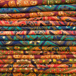 Heap of cloth fabrics at a local market in India. — Stock Photo
