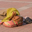 Stock Photo: HARIDWAR, INDI- NOV 8: unidentified homeless msleeps on sidewalk near River Ganges on November 8, 2012 in Haridwar, India. Poor Indians flock to Haridwar for charity.