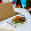 Dining by the pool — Stock Photo