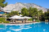 Swimming pool at summer resort — Stock Photo