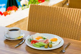 Breakfast by the pool — Stock Photo