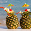 Two tropical cocktails on the beach - Stock Photo
