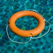 Life buoy in blue swimming pool — Stock Photo