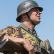 KIEV, UKRAINE -MAY 11: Member of Red Star history club wears historical German uniform during historical reenactment of WWII, May 11, 2013 in Kiev, Ukraine — Stok fotoğraf