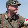 KIEV, UKRAINE -MAY 11: Member of Red Star history club wears historical German uniform during historical reenactment of WWII, May 11, 2013 in Kiev, Ukraine — Foto de Stock