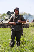 KIEV, UKRAINE -MAY 11: Member of Red Star history club wears historical German uniform during historical reenactment of WWII, May 11, 2013 in Kiev, Ukraine — Stock Photo
