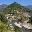 Devprayag is last prayag of AlaknandRiver and from this point confluence of Alaknandand Bhagirathi River is known as Ganga. Uttarakhand, India. — Stock Photo #25723101
