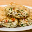 Pita bread wrapped with cottage cheese and vegetables — Stock Photo #26069261