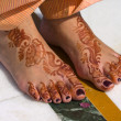 Henna on feet of bride from India — Stock Photo