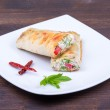 Pita bread wrapped with cottage cheese and vegetables — Stock Photo #28141881