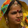 PUSHKAR, INDIA - NOVEMBER 21: An unidentified girl attends the Pushkar fair on November 21, 2012 in Pushkar, Rajasthan, India. Pilgrims and camel traders flock to the holy town for the annual fair. — Stock Photo #28918735