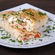 Pita bread wrapped with cottage cheese and vegetables — Stock Photo