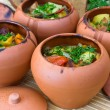 Meat baked with vegetables in rustic clay pot — Stockfoto