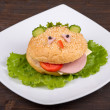Fun food for kids - hamburger looks like a funny muzzle — Stock Photo