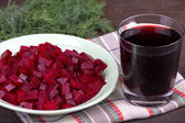 Fresh segments of a beet and beetroot juice — Stock Photo