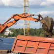 Stock Photo: Excavator loading sand on dumper truck