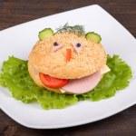 Fun food for kids - hamburger looks like a funny muzzle — Stock Photo #31266103