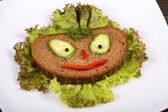 Fun food for kids - face on bread — Stock Photo