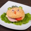 Fun food for kids - hamburger looks like a funny muzzle — Stock Photo #31935763