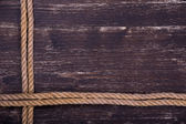 Image of old texture of wooden boards with ship rope — Stockfoto
