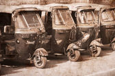 Auto rickshaw taxis in Agra, India. Artwork in retro style. — Stock Photo