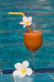 Tropical juice at the swimming pool — Stock Photo