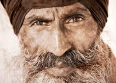 Sikh man in Amritsar, India. Artwork in retro style. — Stock Photo