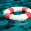 Life buoy in swimming pool — Stock Photo