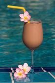 Chocolate shake at the swimming pool — Stock Photo