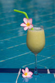 Apple banana shake at the swimming pool — Stock Photo