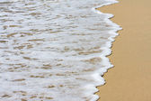 Sand beach water background — Stock Photo