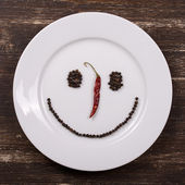 Happy smiley face on dish plate — Stok fotoğraf
