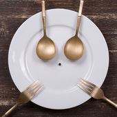 Happy face on dish plate — Stock Photo