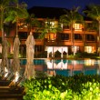 Thai resort with pool at night view — Stock Photo