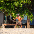 Man playing with frisbee on tropical beach in Koh Phangan, Thailand. — Stock Photo