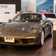 Foto Stock: Porsche 911 CarrerS car on display at Siam Paragon Mall in Bangkok, Thailand.