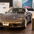 Foto de Stock  : Porsche 911 CarrerS car on display at Siam Paragon Mall in Bangkok, Thailand.