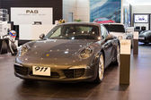 Porsche 911 Carrera S car on display at the Siam Paragon Mall in Bangkok, Thailand. — Stok fotoğraf