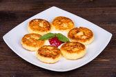 Delicious homemade cheese pancakes closeup — Stock Photo
