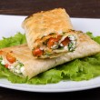 Pita bread wrapped with cottage cheese and vegetables — Stock Photo #36800035