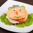 Fun food for kids - hamburger looks like a funny muzzle — Stock Photo #37165979