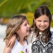 Stock Photo: Happy little girls enjoy summer day at beach