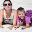 Happy family enjoy summer day at beach — Stock Photo #38746835