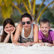 Happy family enjoy summer day at beach — Stock Photo #38746957