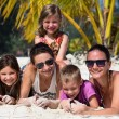 Happy family enjoy summer day at beach — Stock Photo #38747045
