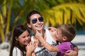Happy family enjoy summer day at the beach — Stock Photo