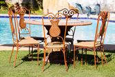 Table and chairs next to the pool in Philippines — Stok fotoğraf