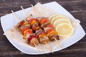 Grilled meat and vegetables on skewer — Stock Photo